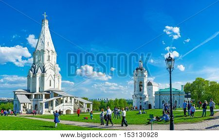 MOSCOW RUSSIA - MAY 10 2015: The architectural ensemble of Kolomenskoye with the white stone Ascension Church St George the Victorious Bell Tower and Water Tower on the background on May 10 in Moscow.