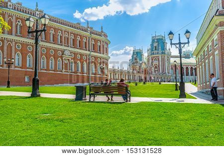 MOSCOW RUSSIA - MAY 10 2015: The benches around the buildings of Tsaritsyno Imperial Residence are perfect place to relax and enjoy the magnificent views on May 10 in Moscow.