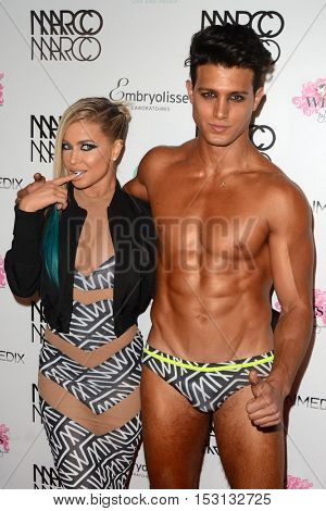 LOS ANGELES - OCT 21:  Carmen Electra, Asaf Goren at the Marco Marco Fashion Show at Globe Theater on October 21, 2016 in Los Angeles, CA