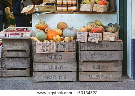 LONDON UNITED KINGDOM - NOVEMBER 16: Gourds and Pumpkins Shop in London on NOVEMBER 16 2013. A Variety of Pumpkins and Squashes for Sale at Borough Market in London United Kingdom.