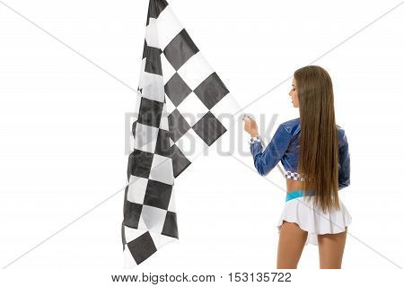 Back view of attractive brunette posing with checkered flag