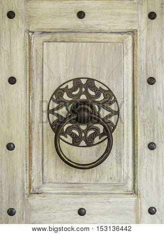 Closeup hang door knocker metal on wooden background