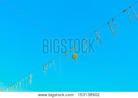 Garland Made With Strips Of Cloth Hung With A Cd With Background Of Blue Sky
