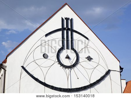 The Sun clock as an exterior on a side of a building in Kaunas old town (Lithuania).
