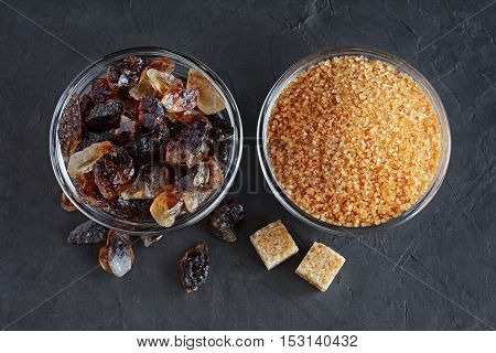 Caramelized Sugar And Brown Cane Sugar In Glass Bowls