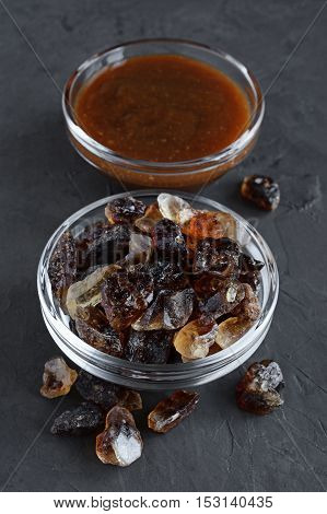 Caramelized Sugar And Liquid Caramel In Glass Bowls