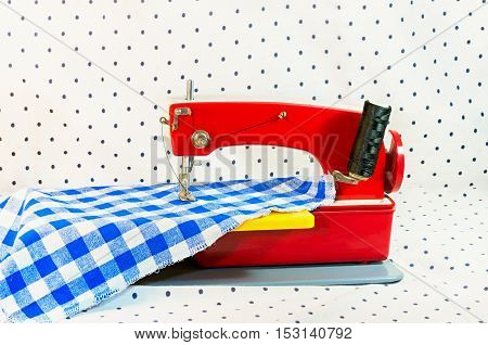 sewing machine children's toy red and blue handkerchief on a white background with points