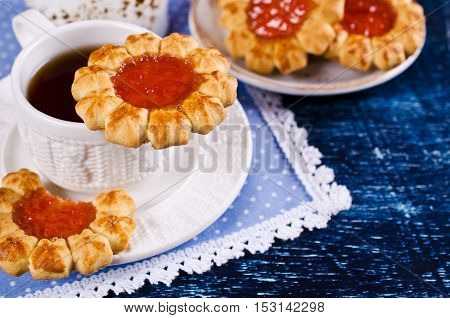 Shortbread with jam on a dark background. Selective focus.