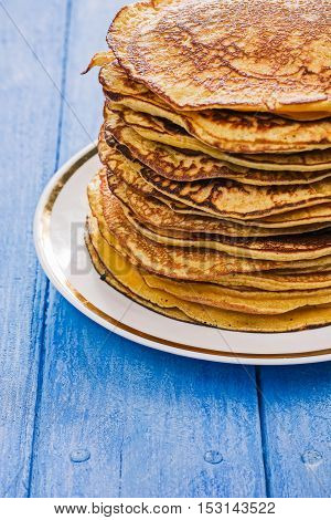 Stack of prepared pumpkin pancakes on the plate