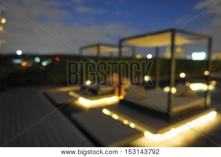 blur photo of sun bathing bed with bokeh light in the dark at night time