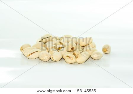 Close up of Pistachio nuts on white background