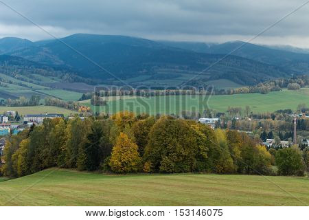 Mountain landscape with clouds in early autumn
