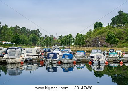 Small fishing boats at Falkensten village camping. Norway.