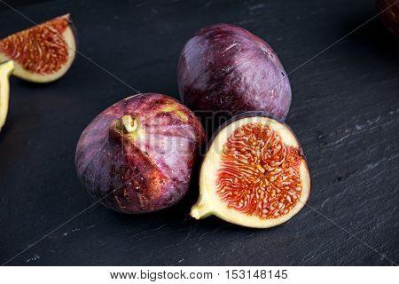 Fresh Figs slice on black stone board.