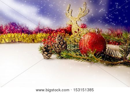 Christmas golden deer with  cones and sparkling stars