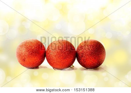Red christmas baubles on the sparkling background