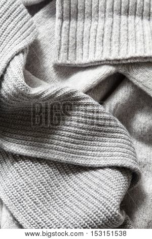 large folds on the warm knit grey scarf