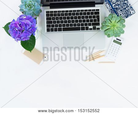 Modern Laptop keyboard and phone on white table mock up flat lay scene, copy space on table