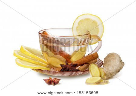 A cup of ginger tea with lemon, cinnamon and anise stars. Ginger tea  isolated on white background