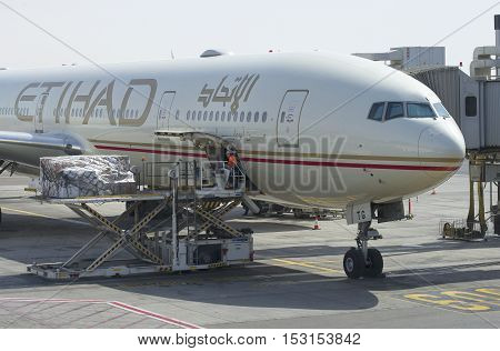 ABU DHABI, UAE - MARCH 27, 2015: The loading of the aircraft Airbus A320-200 company