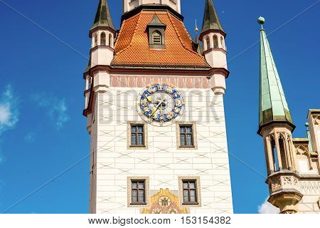 Close-up view on the clock tower of the old town hall on Mary's square in Munich