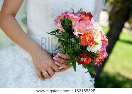 Bride holding big wedding bouquet on wedding ceremony.