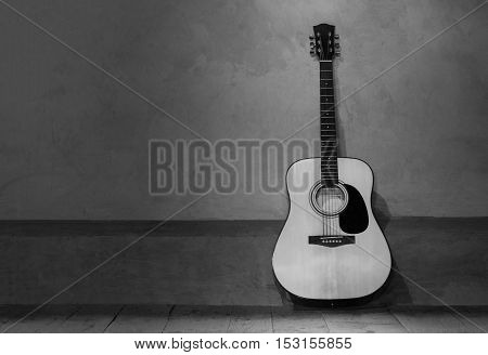 Guitar music instrument against wall background poster