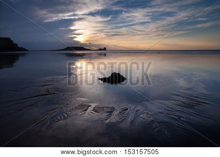 Worms Head rockpool Sunset at Rhossili Bay and Worms Head on the Gower peninsula, South Wales