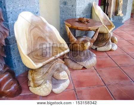 Ubud Indonesia - April 12 2012: Carved wooden chairs and table in the shop at Ubud Indonesia
