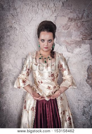 Beautiful Woman In Old Medieval Dress Holding Something In Hands