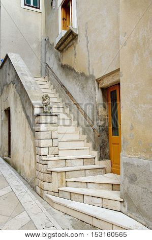 Senj Croatia: a small town in northern Croatia located on the Adriatic coast. Narrow street in the old town, stairs. architectural detail.