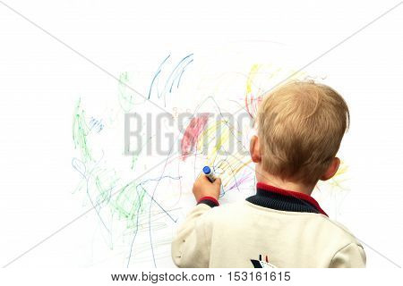 Boy painted with colored pencils on white wall
