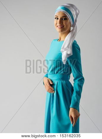 Muslim young woman on grey