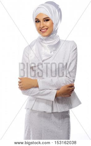 Muslim young woman on white