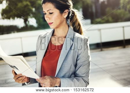 Businesswoman Reading Newspaper Information City Concept