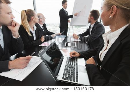 Business people analyzing financial figures of reports