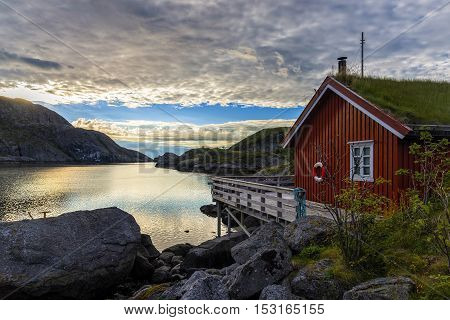 Sunrise in Nusfjord village, Norway. Nusfjord is one of the oldest and best preserved fishermen village of Lofoten islands. Currently is not inhabited permanently but rather a museum