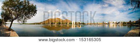 mountain and reflection in lake alcudia mallorca