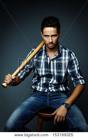 Handsome bearded man wearing shirt with bat, portrait shot in studio