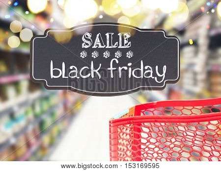 red cart in supermarket store with sale black friday text on black lable