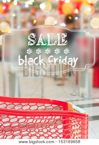 cart in supermarket store with sale black friday text on black lable