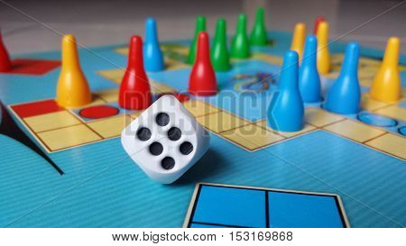 Board game - chinese, colorful pawns and dice