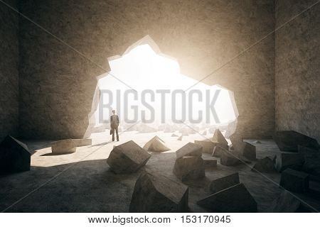 Back view of businessman with briefcase in concrete interior with broken wall city view and sunlight. Research concept. 3D Rendering