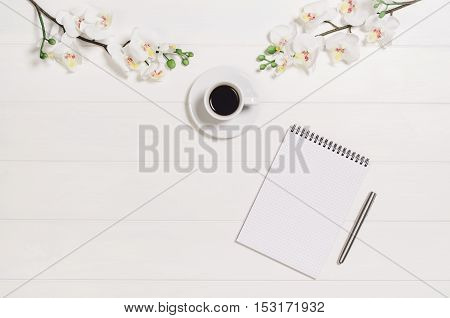 Feminine, elegant woman's white, wooden table, desk or workspace seen from above. Top view background with copy space. Creative workspace for freelance girl working from home