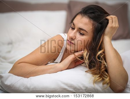 Beautiful Young Girl Lying On White Bed