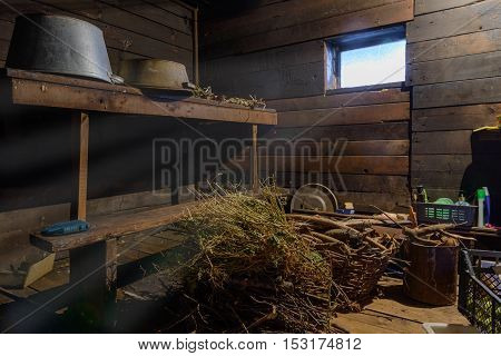 scattered things in a wooden shed with window