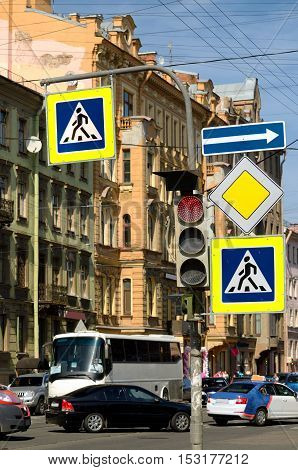 On the streets of busy traffic.Road signs regulate traffic rules.
