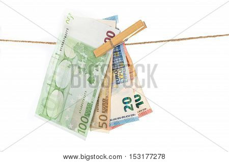 Euro Banknotes Hanging On Clothesline On White Background.