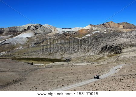 Van cruising an abondend road in the peruvian andes mountains in a very nice moon valley