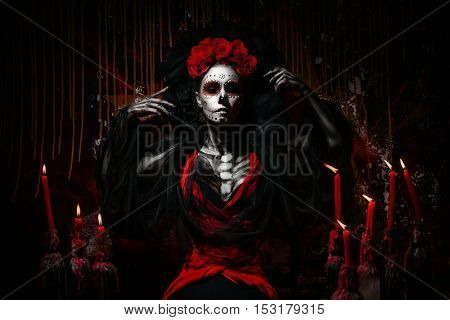Portrait of a dead girl with candles